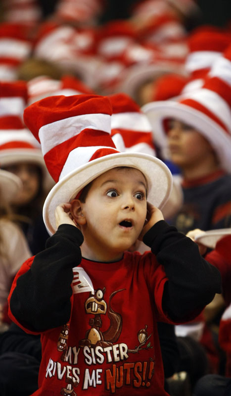 First grader Connor Epstein is pretty excited about the Cat in the Hat and assembly.