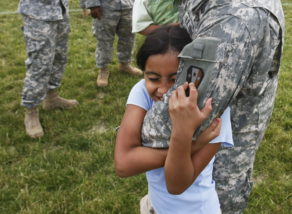 Capt Nicholas Calenicoff of Charlie comapny 113th 2nd is held by his daughter Nicholle 9 before the farewell ceremony and barbecue for the 3,000 NJ Army guard troops leaving for Texas then Iraq at Fort Dix in Wrightstown.