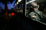 PFC Paul Garner of West Deptford closes his eyes as he waits for the bus to move. Soldiers board the buses to the aiirport at the Freehold National Guard armory in Freehold