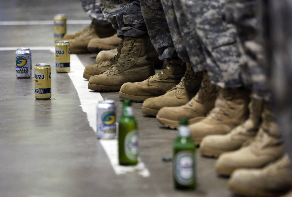 Beer, soda for soldiers who don't drink, for the last beer ceremony. The last beer are distributed at the Freehold National Guard armory in Freehold.  New Jersey National Guard Bravo Company 1-114th. Family has left and Military order number one, a ban on alchohol, will soon go into effect. No alchohol for the deployment