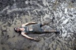 Charrio High School runner becomes one with the mud after the rains hits the cross country course  at the New Jersey Runners at the Manhattan Cross Country invitational in the Bronx.