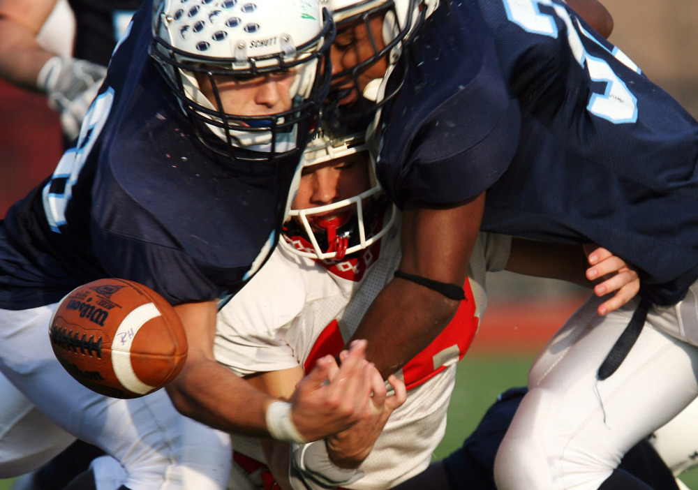 West Orange Kevin Skokandich along with teammate Ben Boursiquot  jar the bar away from Bloomfield receiver Kevin Miller in the second half. Bloomfield High School boys football team versus West Orange High School football in the North Jersey Section 1 Group 4 football quarterfinal game at West Orange.