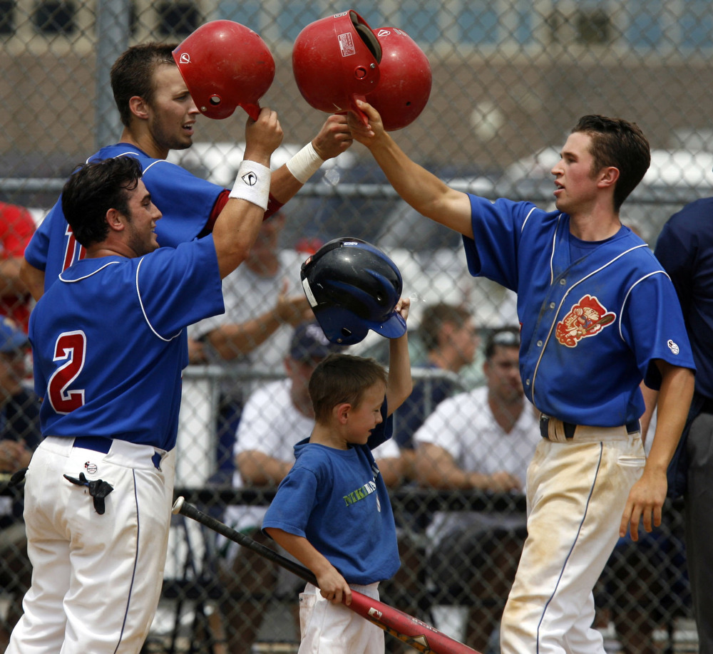 Joe Favatella of Washington Township hit a grad slam and is greeted at home during the NJSIAA Group 4 baseball final between Randolph and Washington Township.