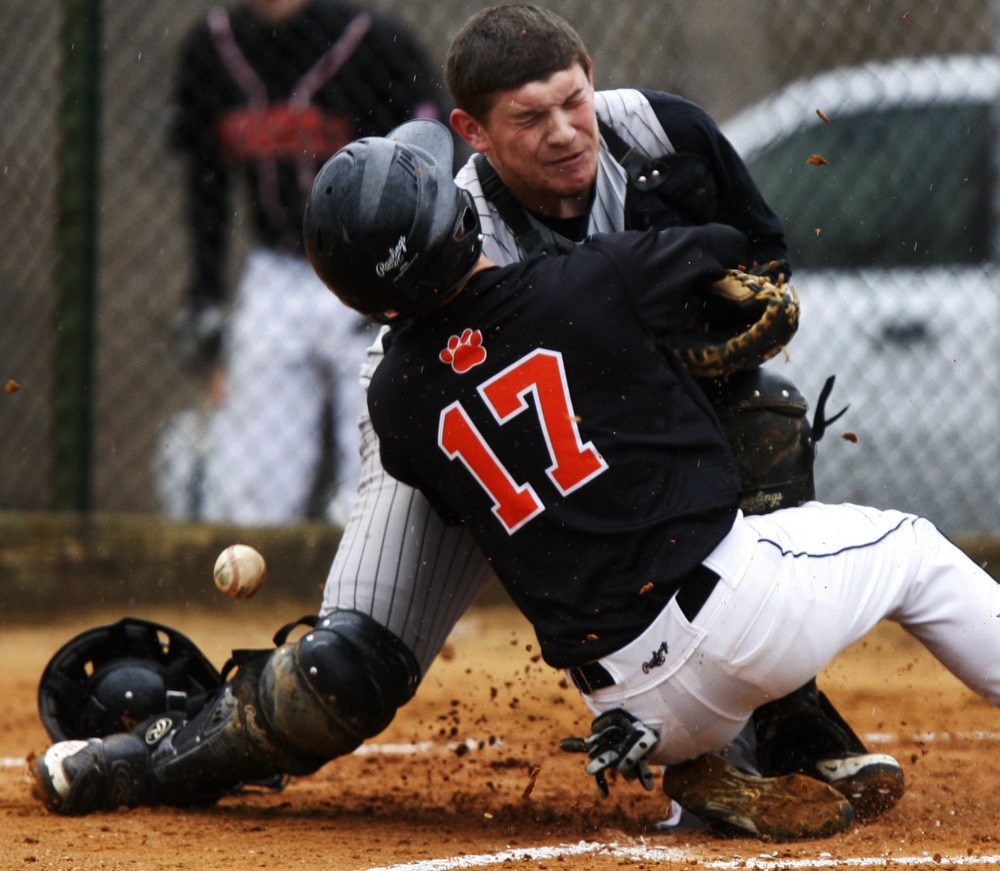 Hackettstown's Brendan O'Brien plows into North Planfield catcher Alex Pena safely for the first run during the Hackettstown High School boys baseball team defeat of the North Plainfield High School boys baseball team 11-0.