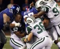Bart Scott lost his helmet but ended up with the ball after casuing a fumlbe during the Jets versus Giants National Football Leauge game in East Rutherford