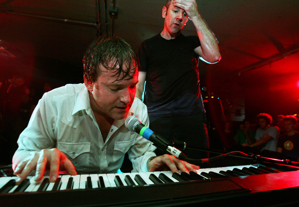 Kevin  Whelan plays the keyboard as Charles Bissel  wipes the sweat from his brow at the end of the show.