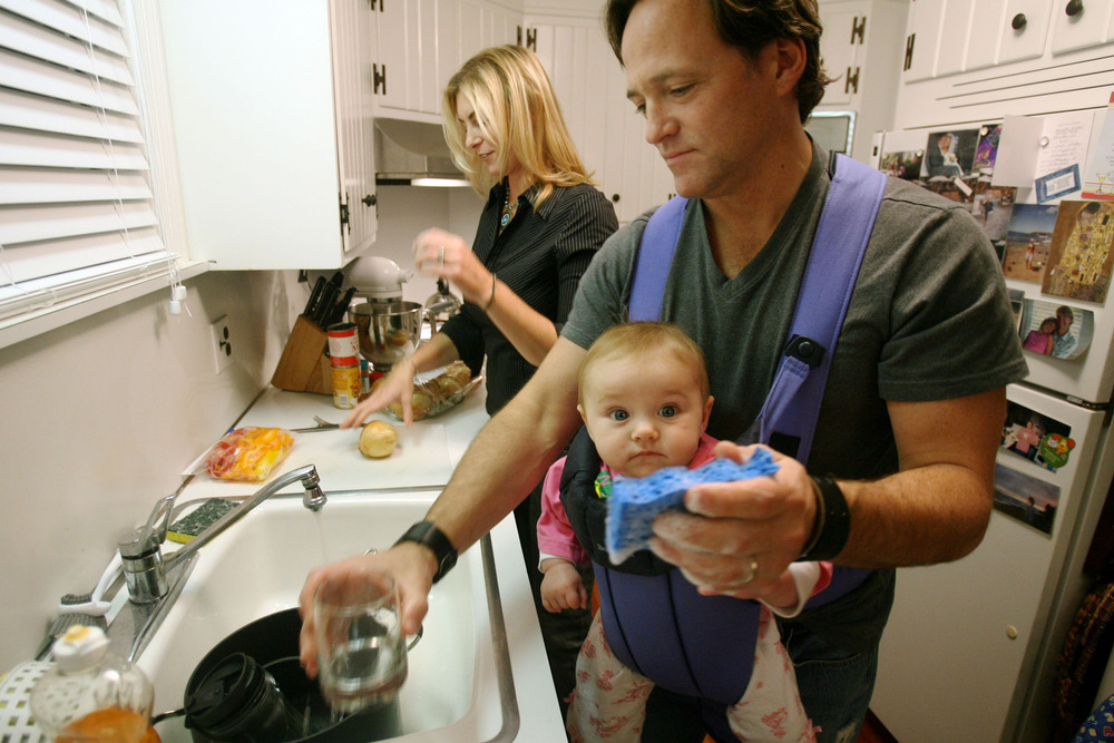 Greg Whelan of the Wrens at his Teaneck home with wife Michelle Whelan, daughter Sophhia Whelan 5 1/2 months and dog Lola on Monday night . Greg does the dishes with Sophhia while Michelle makes dinner.