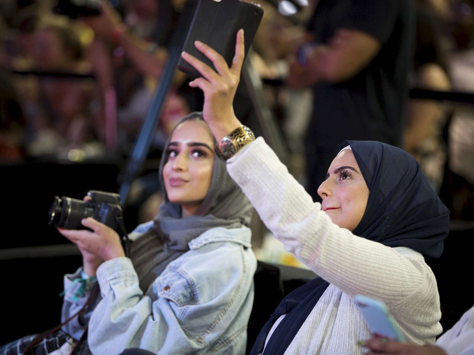 "Aamine Tahir and Fariza Javed were among those who showed up to watch the rapper Snoop Dogg give a presentation called ""Immaculate Hair Game."""
