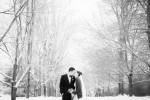 Photography of wedding couple kissing on path at Knox Farm in the snow