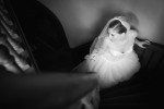 Photography of bride on stairs before her wedding at Belhurst Castle in Geneva, NY