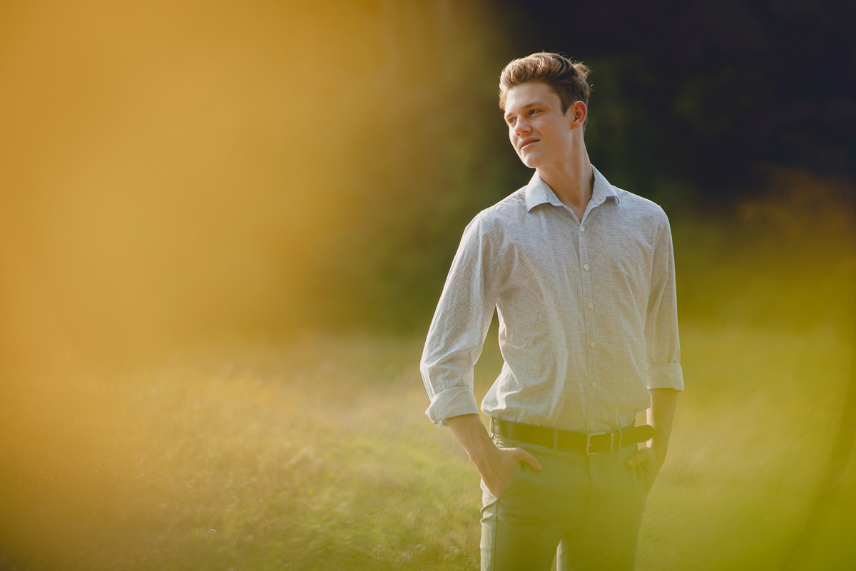East Aurora High School senior looks over shoulder during portrait session at Knox Farm State Park near Buffalo, NY