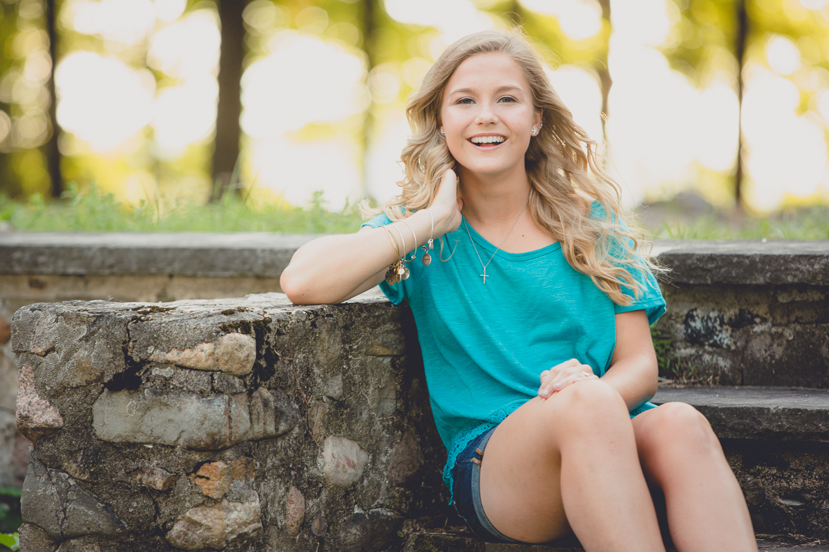 senior portrait by photographer Lindsay DeDario of maple grove high school student smiling at camera at Long Point State Park in Bemus Point, a small town near Buffalo, NY in WNY