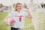 senior portrait by photographer Lindsay DeDario of maple grove high school student leaning on soccer net while holding ball in Bemus Point, a small town near Buffalo, NY in WNY