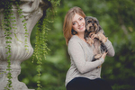 senior portrait by photographer Lindsay DeDario of maple grove high school student with yorkie dog in her arms at Chautauqua Institute, a small town near Buffalo, NY in WNY