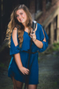 senior portrait by photographer Lindsay DeDario of maple grove high school student smiling with microphone in Jamestown, NY, a small city near Buffalo in WNY