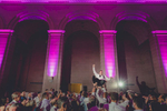 groom is thrown in the air by guests while dancing at wedding in the Admiral Room Ballroom in Buffalo, NY
