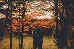 couple stands in silhouette during the fall in ellicottville, NY  during their wedding engagement photography session