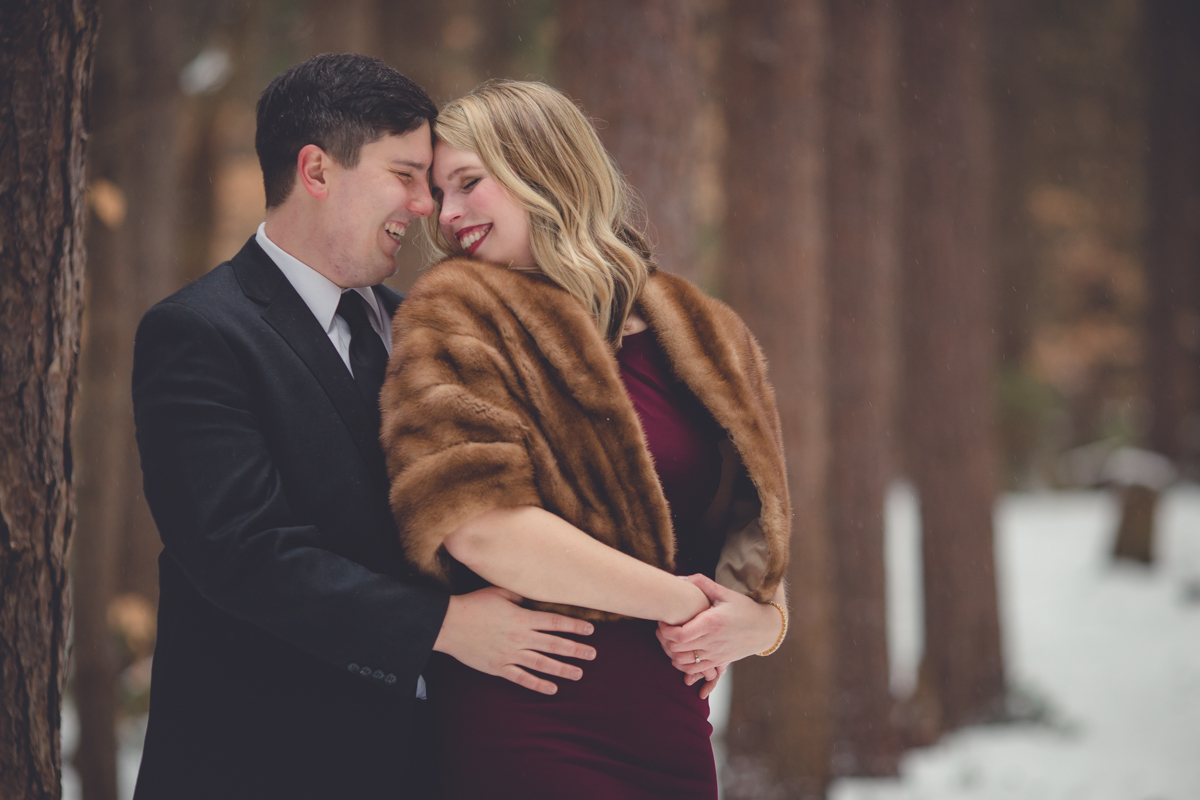 groom hugs bride during engagement portrait photography session at Erie County Forest near Buffalo, NY