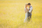 Wedding photography of couple around sunset as they dance in field at Knox Farm State Park in East Aurora, NY outside of Buffalo, NY