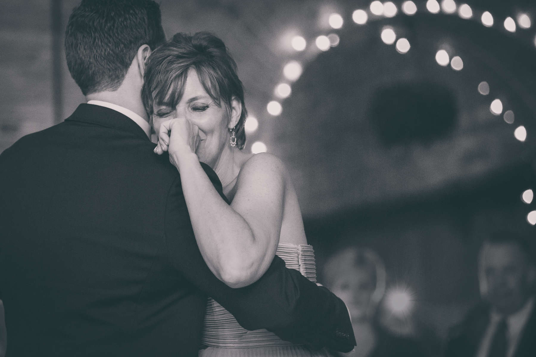 Mother holds back tears as she dances with her son, the groom, at his wedding at Pearl at the Webb Building in Buffalo, NY