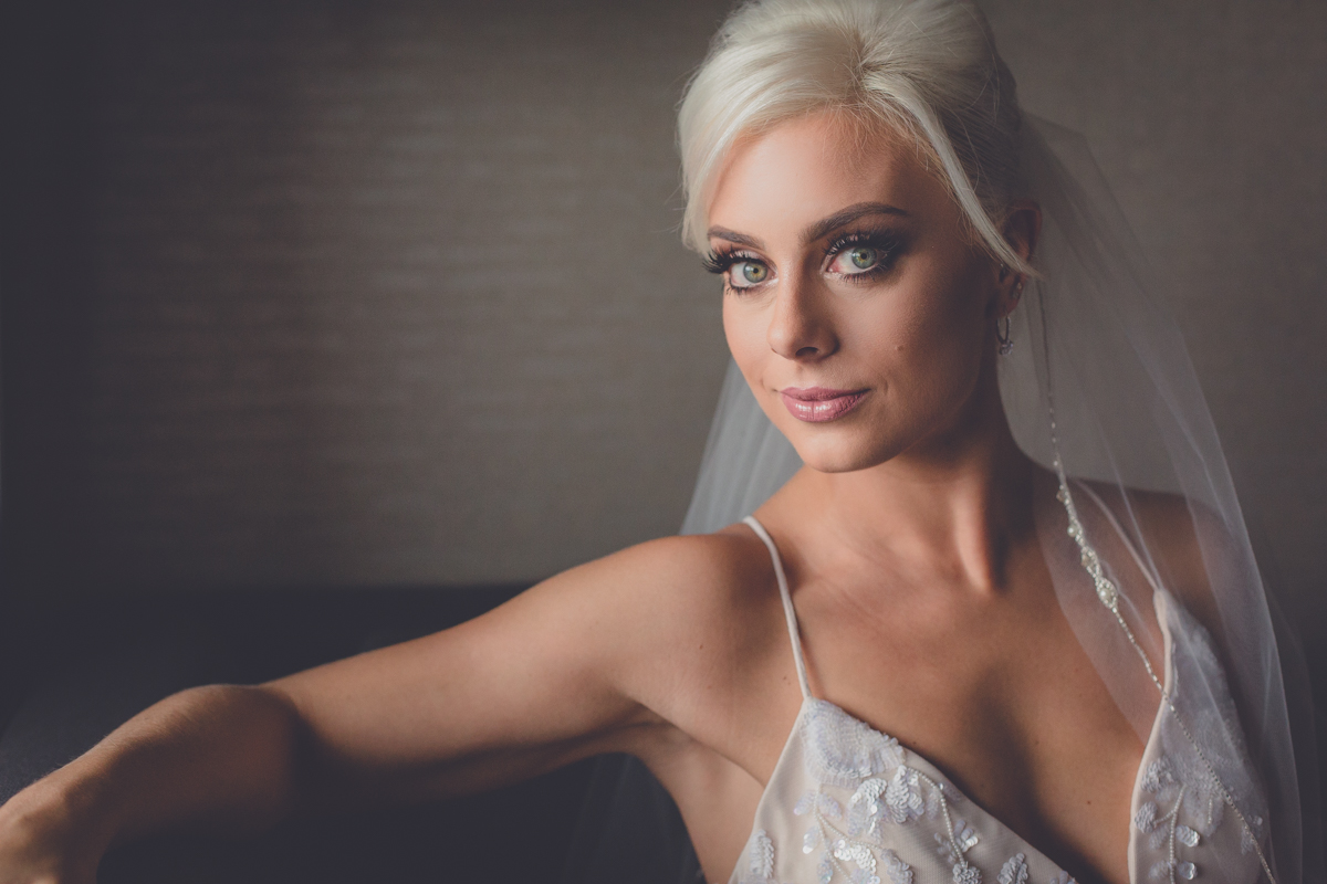 wedding portrait photography of bride sitting on couch in Rochester, NY