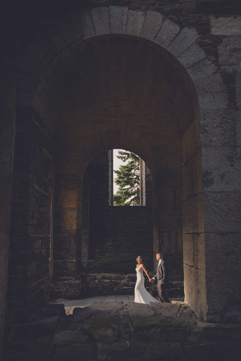 bride and groom walk through abandoned St. Joeseph's church on their wedding day in Rochester, NY