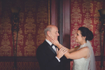 bride holds fathers face after first look in Georgian Ballroom at her Statler City wedding in Buffalo, NY