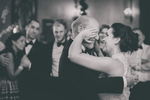 bride wipes tears from father's face during dance in Terrace Room at Statler City wedding reception in Buffalo, NY