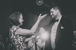 groom and mother dance in terrace room ballrom during Statler City wedding reception in Buffalo, NY