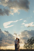 bride and groom embrace on hill during sunset at Tifft Nature Preserve in Buffalo, NY