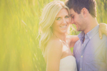 engagement photography of groom looking at bride in field in buffalo ny at tifft nature preserve