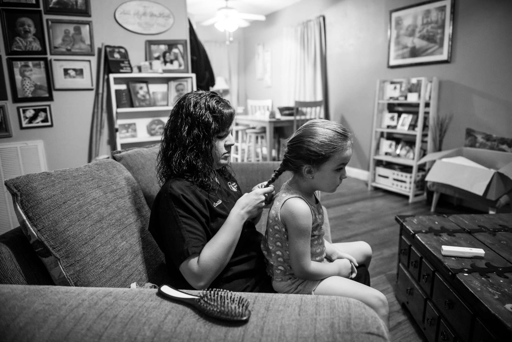 Caitlin Bell fixing daughter Kessler McCarver's hair before they leave the house in the morning on August 21. 2013 in Chattanooga, TN.