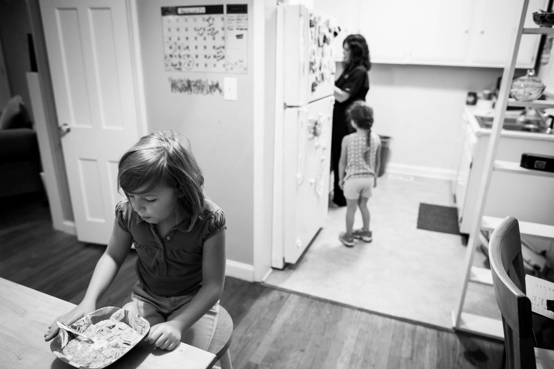 Caitlin Bell at home in Chattanooga, TN with her daughters Zoey McCarver, 8-years-old, and Kessler McCarver, 4-years-old on the morning of August 21, 2013.