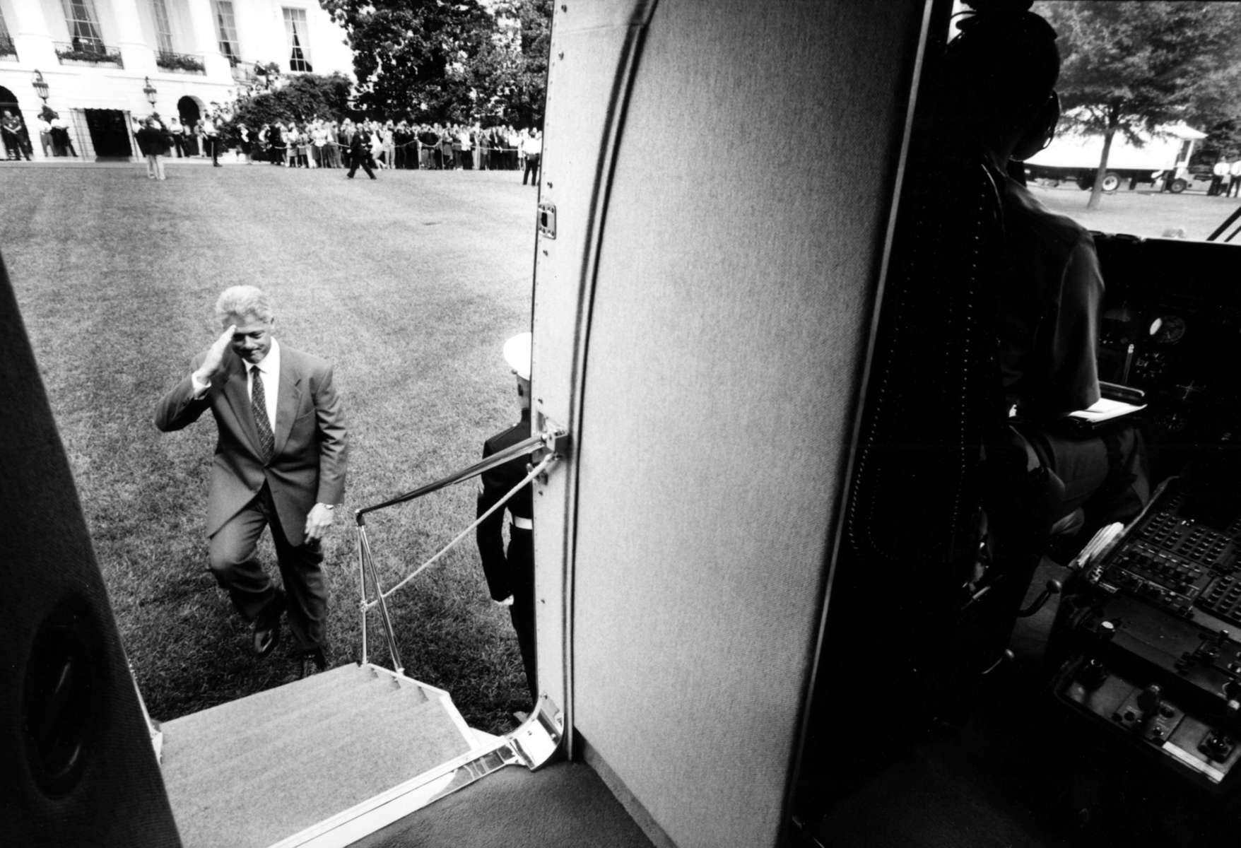 President Bill Clinton salutes as he boards the Marine One helicopter on the South Lawn of the White House. Photograph by Barbara Kinney, The White House