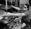 Marcus Padula, drummer for Deep Blue dJinn, quiets his cymbals during a demo session in Marlborough, MA. Padula, who is blind, has reversed the layout of the drum kit and cymbals typically used by drummers to allow him to play with greater speed and accuracy.