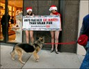 Protesters from PETA (People for the Ethical Treatment of Animals) get out a holiday message.