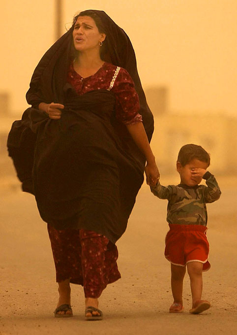 Kamal is caught in a sandstorm with her son.