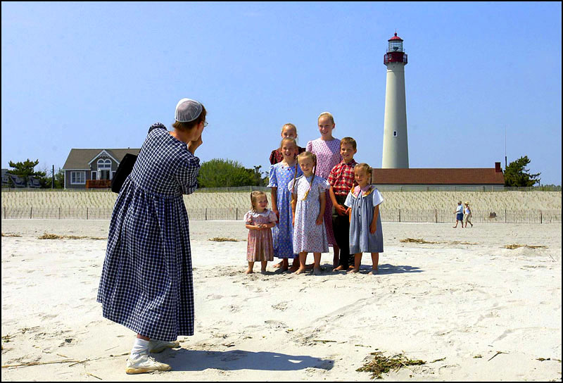 Expecting her eighth child in three weeks, Anita Shirk photographs her family in  Cape May, NJ.