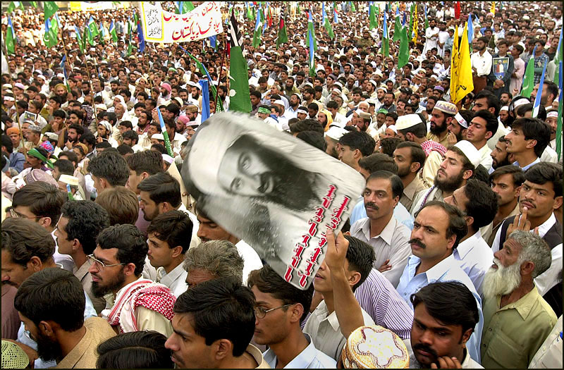 Thousands of demonstrators praise Osama bin Laden during a protest in Rawalpindi. Gen. Pervez Musharraf, Pakistan's president, strongly backed the U.S. attacks on Afghanistan and said civil unrest in his country could be easily controlled.