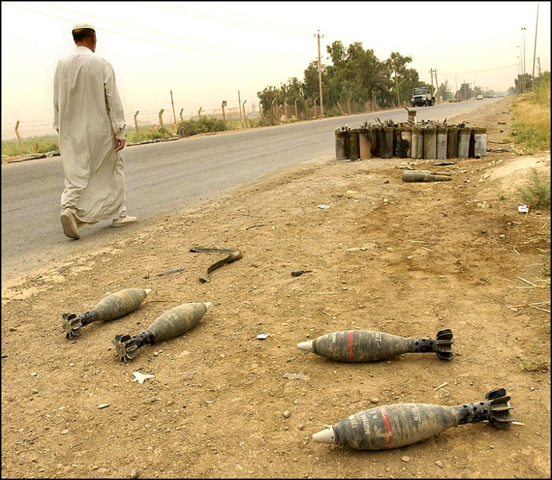 Shell casing and bomb shells litter the side of Al-Canat Rd. in southern Baghdad in front of a former Iraqi military base.