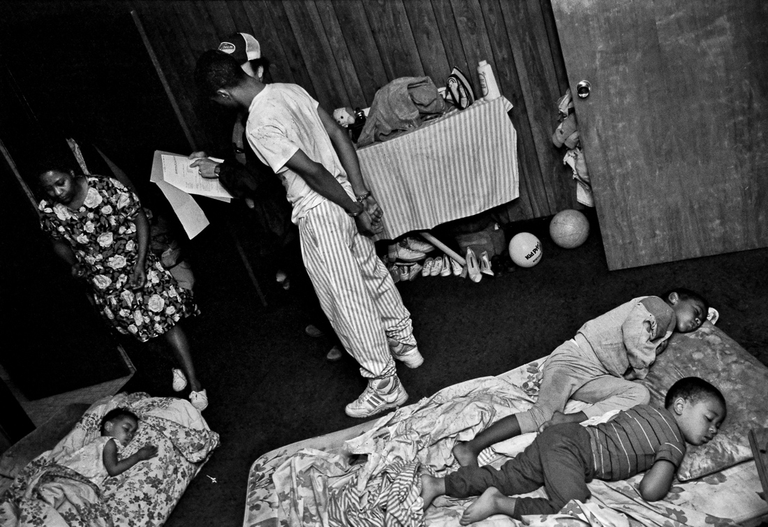 Children slumber while an arrest is made in their Indianapolis apartment.