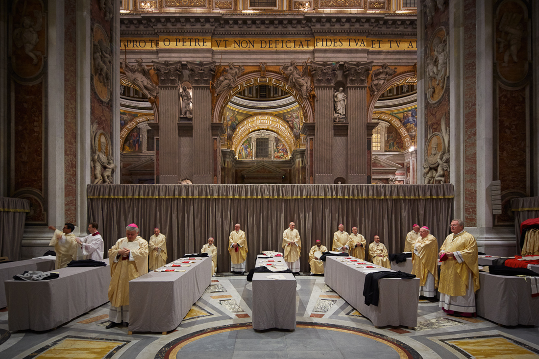 Cardinals and bishops prepare for a holy mass on Christmas Eve in St. Peter's Basilica, in a cordoned off area of the basilica.