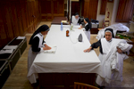 Nuns iron robes to be worn by priests at Vatican City masses.