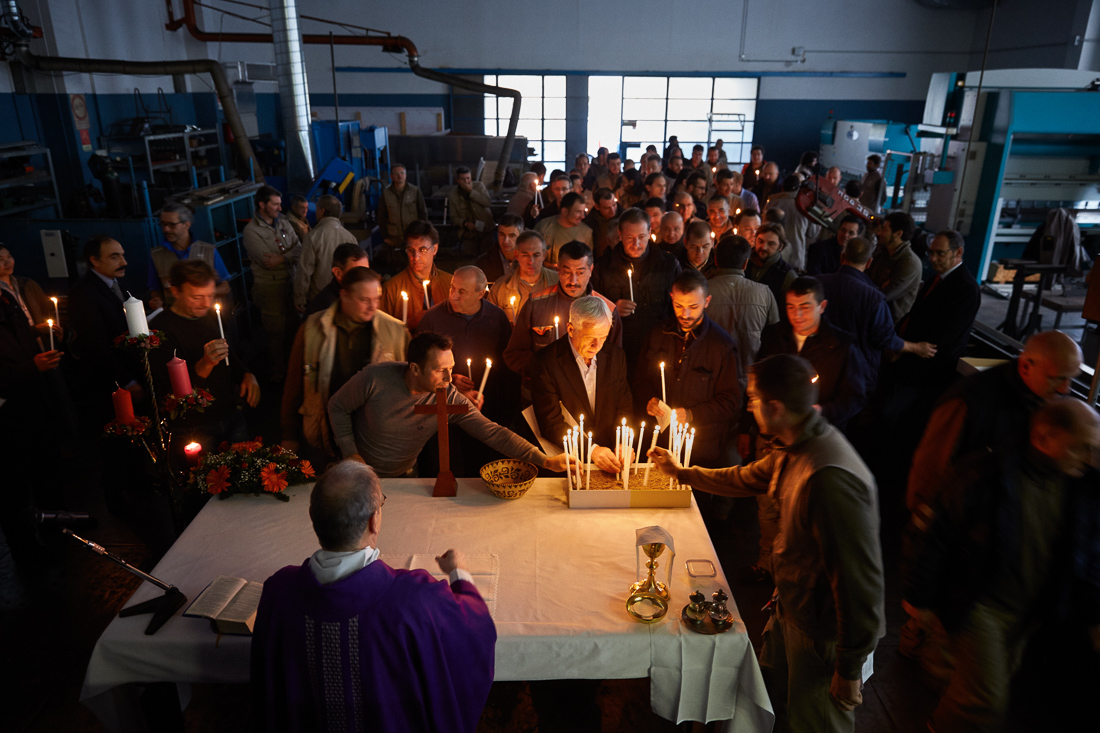 Father P. Bruno Silvestrini leads a mass at a machine shop on Vatican City grounds. Vatican City has a small industrial sector with workers devoted to keeping the city running.