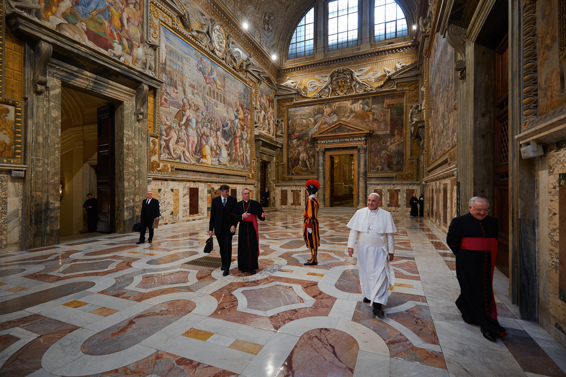 Pope Francis passes through Sala Regia  after his {quote}Urbi et Orbi{quote} address on Christmas Day.