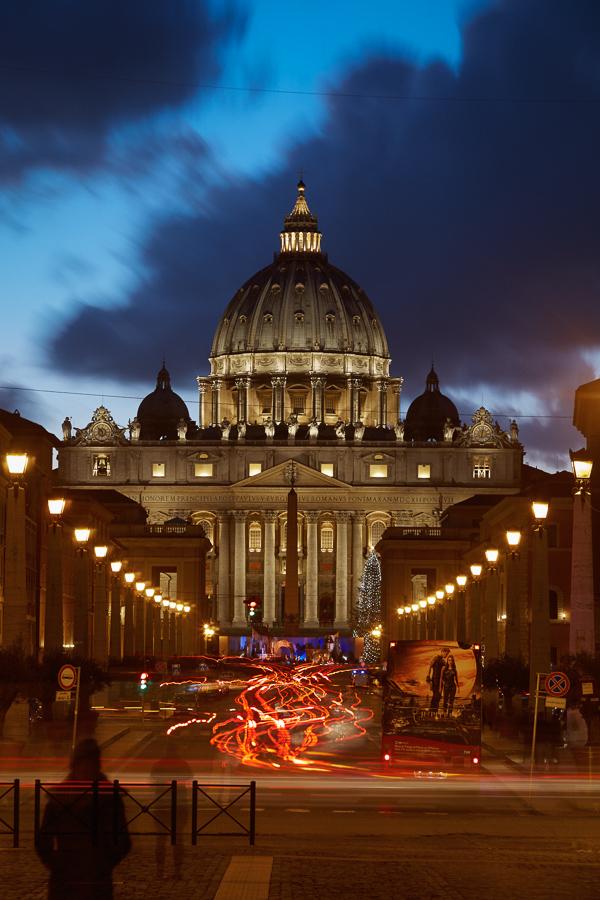 Via della Conciliazione at night, with St. Peter's Basilica in the background.