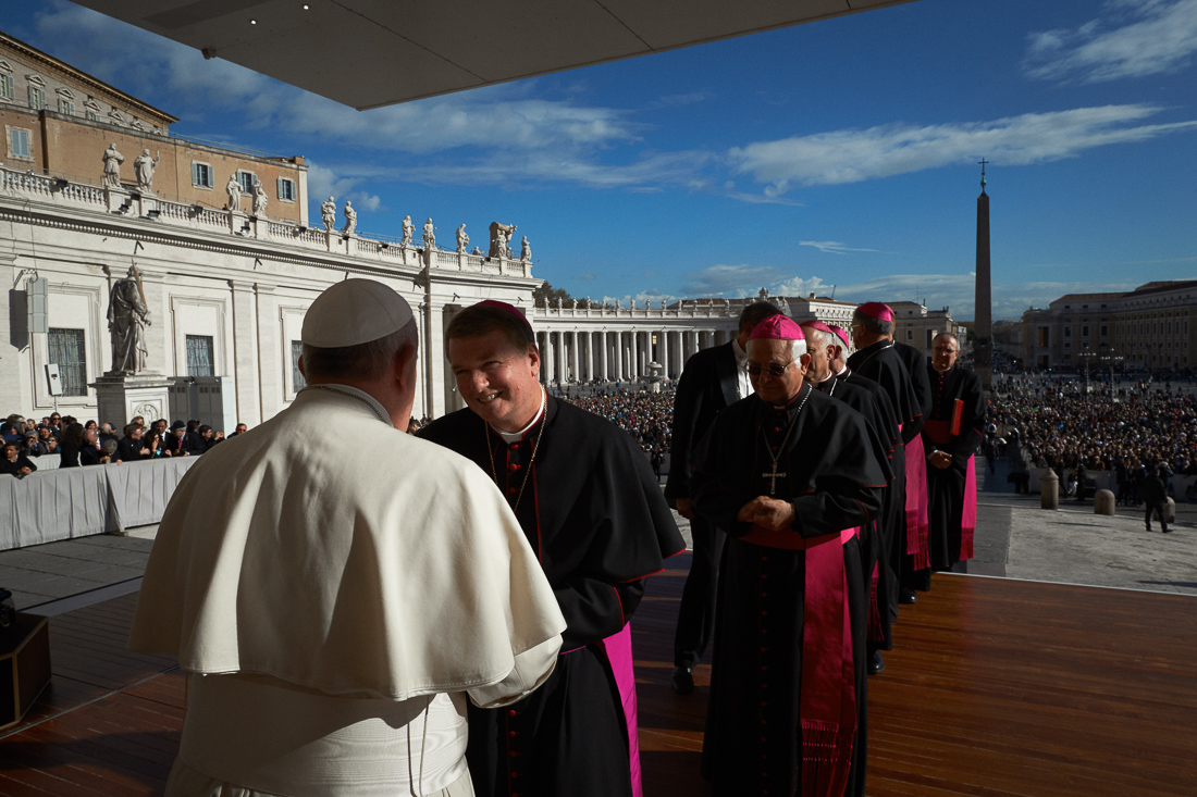 Pope Francis greets clergy and dignitaries during a general audience in Vatican City.