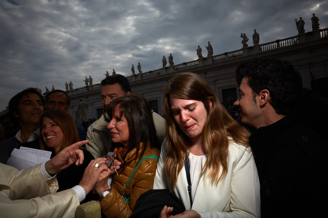 Pilgrims rejoice as Pope Francis approaches them during a general audience in Vatican City.