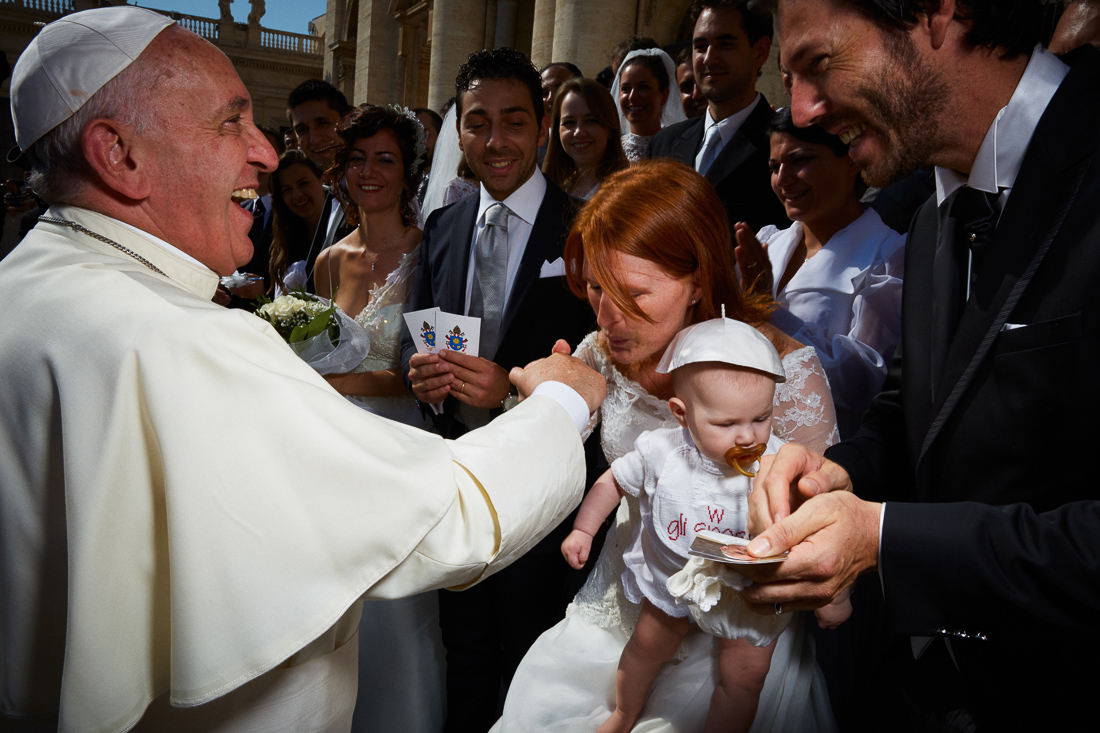 Pope Francis blesses newlyweds during a general audience.