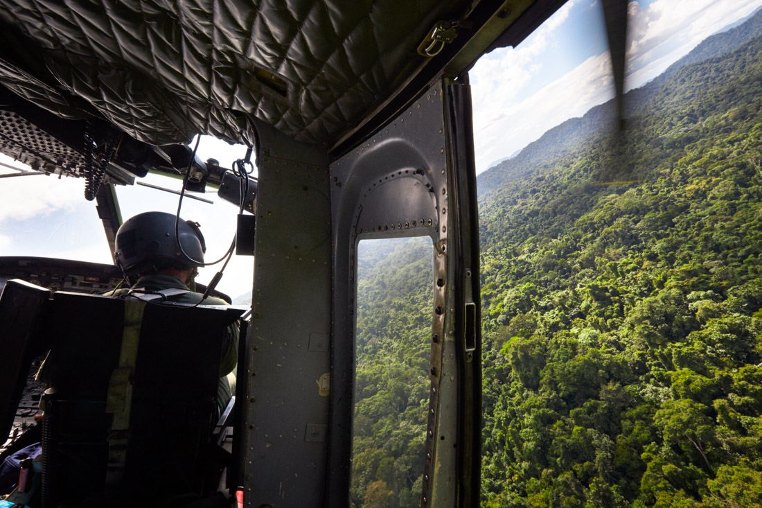 A Honduran military helicopter ferrying archeologists into the Mosquitia jungle approaches the camp landing zone.